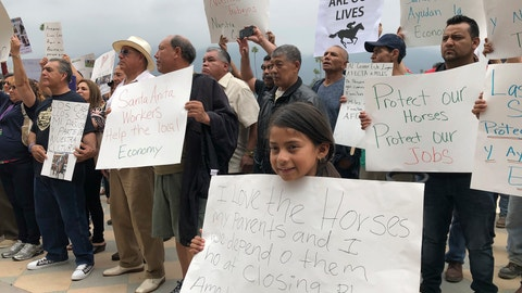 <p>               Santa Anita Park workers with their family members hold a rally at the track in Arcadia, Calif., Friday, June 20, 2019. Santa Anita has put together a five-member team to review horses' medical, training and racing history for the final six racing days at the Southern California track where 29 horses have died since December. The Arcadia track season ends June 23, with racing Friday, Saturday and Sunday this week and next. (AP Photo/Beth Harris)             </p>