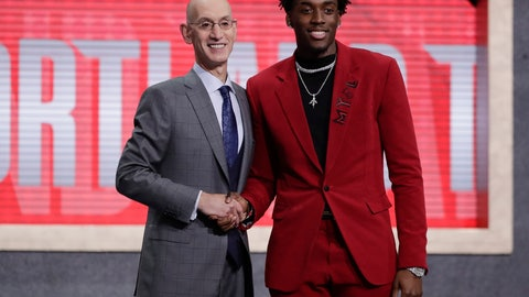 <p>               NBA Commissioner Adam Silver, left, poses for photographs with North Carolina's Nassir Little after the Portland Trail Blazers selected him with the 25th pick overall in the NBA basketball draft Thursday, June 20, 2019, in New York. (AP Photo/Julio Cortez)             </p>