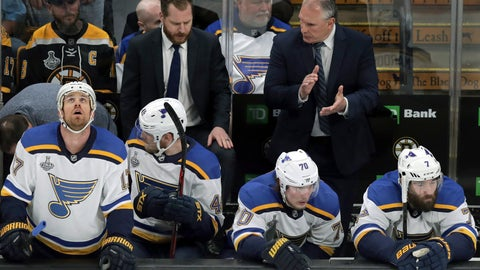 <p>               St. Louis Blues head coach Craig Berube, right rear, exhorts his players during the first period in Game 5 of the NHL hockey Stanley Cup Final against the Boston Bruins, Thursday, June 6, 2019, in Boston. (AP Photo/Charles Krupa)             </p>