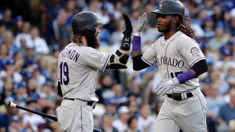 <p>               Colorado Rockies' Raimel Tapia, right, celebrates his solo home run with Charlie Blackmon during the seventh inning of the team's baseball game against the Los Angeles Dodgers on Saturday, June 22, 2019, in Los Angeles. (AP Photo/Marcio Jose Sanchez)             </p>