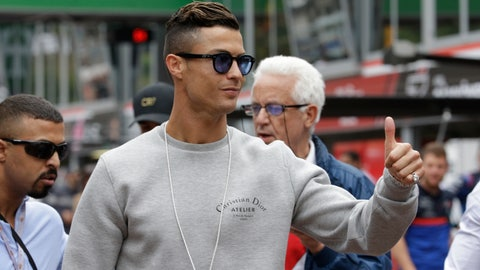 <p>               FILE - In this May 23, 2019, file photo, Cristiano Ronaldo applauds fans at the pit line ahead of the second practice session at the Monaco racetrack, in Monaco. A lawsuit filed last September in Nevada state court accusing Cristiano Ronaldo of rape has been dropped by a woman who alleges the soccer star paid her $375,000 to keep quiet about a 2009 Las Vegas hotel penthouse encounter. But a federal lawsuit filed in January by the same woman is still active, and Las Vegas police say their investigation of the allegations remains open. Ronaldo lawyer Peter Christiansen declined Wednesday, June 5, 2019,  to comment about the voluntary dismissal of the state lawsuit last month.  (AP Photo/Luca Bruno, File)             </p>