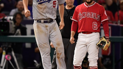 <p>               Los Angeles Dodgers' Corey Seager, left, winces after injuring himself while rounding third on a single by Alex Verdugo as Los Angeles Angels third baseman David Fletcher stands by during the ninth inning of a baseball game, Tuesday, June 11, 2019, in Anaheim, Calif. (AP Photo/Mark J. Terrill)             </p>