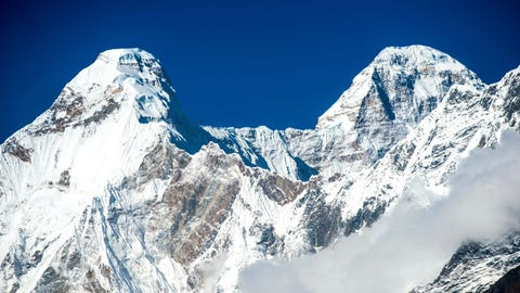 <p>               In this Oct. 7, 2016, photograph provided by Juniper Outdoor Pursuits Centre Pvt. Ltd shows Nanda Devi twin peaks which are connected with a razor sharp ridge with a distance of around 2 kilometers running at approximately 6666m height or 22,000 feet., seen from Chaukori in Uttarakhand, India. Indian air force pilots have resumed a search over a Himalayan mountain for a team of mostly foreign climbers missing since late May. The fourth day of the search on Tuesday was taking place in the northern state of Uttarakhand after five bodies were spotted in the snow in high-resolution photos taken Monday. (AP Photo/ Maninder Kohli via Juniper Outdoor Pursuits Centre Pvt. Ltd)             </p>