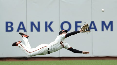 <p>               San Francisco Giants left fielder Mike Yastrzemski dives to catch a fly ball hit by Milwaukee Brewers' Yasmani Grandal for the final out of the ninth inning of a baseball game in San Francisco, Saturday, June 15, 2019. (AP Photo/Jeff Chiu)             </p>
