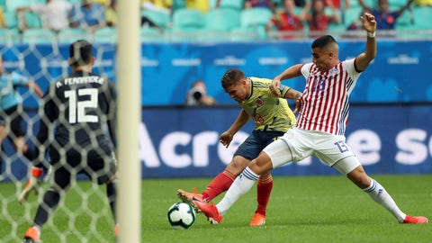 <p>               Colombia's Gustavo Cuellar, center, kicks the ball to score his side's first goal against Paraguay during a Copa America Group B soccer match at Arena Fonte Nova in Salvador, Brazil, Sunday, June 23, 2019. (AP Photo/Ricardo Mazalan)             </p>