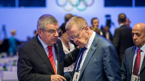 <p>               International Olympic Committee, IOC, President Thomas Bach from Germany, left, speaks with Australian IOC member John Coates, right, during the 134th Session of the International Olympic Committee (IOC), at the SwissTech Convention Centre, in Lausanne, Switzerland, Tuesday, June 25, 2019. (Jean-Christophe Bott/Keystone via AP)             </p>