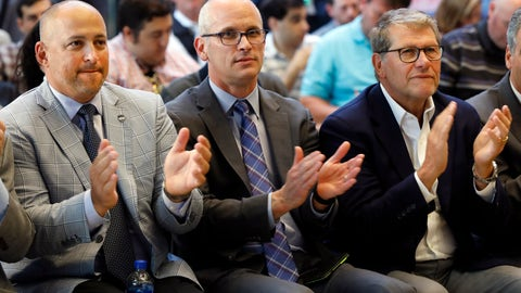 <p>               UConn Director of Athletics David Benedict, left, men's basketball coach Dan Hurley, center, and women's basketball coach Geno Auriemma applaud during the announcement that the University of Connecticut is re-joining the Big East Conference, at New York's Madison Square Garden, Thursday, June 27, 2019. (AP Photo/Richard Drew)             </p>
