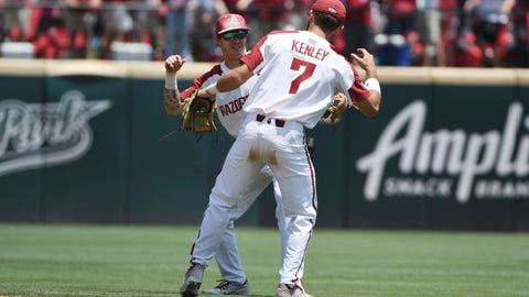 <p>               Arkansas infielders Casey Martin, left, and Jack Kenley celebrate after beating Mississippi 11-2 in Game 1 at the NCAA college baseball super regional tournament Saturday, June 8, 2019, in Fayetteville, Ark. (AP Photo/Michael Woods)             </p>