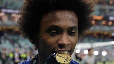 <p>               Chelsea's Willian bites his medal after winning the Europa League Final soccer match between Arsenal and Chelsea at the Olympic stadium in Baku, Azerbaijan, Thursday, May 30, 2019. Chelsea won 4-1. (AP Photo/Luca Bruno)             </p>