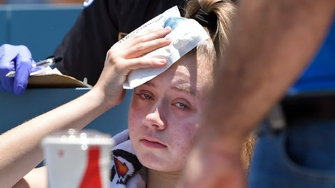 <p>               A young fan holds ice to her head after being hit with a foul ball hit by Los Angeles Dodgers' Cody Bellinger during the first inning of a baseball game against the Colorado Rockies, Sunday, June 23, 2019, in Los Angeles. (AP Photo/Mark J. Terrill)             </p>
