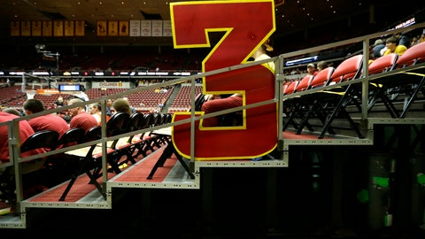 <p>               FILE - In this Jan. 17, 2015, file photo, a large 3-point sign sits in the stands before an NCAA college basketball game between Iowa State and Kansas, in Ames, Iowa. The NCAA Playing Rules Oversight Panel announced Wednesday that the arc will be moved to 22 feet, 1 3/4 inches for the 2019-20 season, matching the international distance. (AP Photo/Charlie Neibergall, File)             </p>