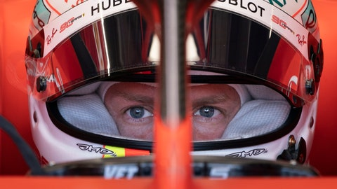 <p>               Ferrari driver Sebastian Vettel of Germany sits in his car during the second practice session at the Formula One Canadian Grand Prix auto race, Friday, June 7, 2019,  in Montreal. (Paul Chiasson/The Canadian Press via AP)             </p>