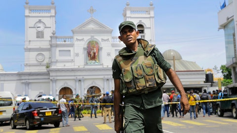 """<p>               FILE - In this April 21, 2019 file photo, Sri Lankan Army soldiers secure the area around St. Anthony's Shrine after a blast in Colombo, Sri Lanka. Sri Lanka's attorney general advised the acting police chief on Monday, June 24, 2019, to launch a criminal investigation of the former defense secretary over """"major lapses"""" that contributed to security failures ahead of Easter Sunday suicide bombings that killed more than 250 people. (AP Photo/Eranga Jayawardena, File)             </p>"""