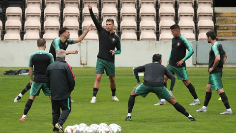 <p>               Portugal's Cristiano Ronaldo, center, gestures during a training session at the Bessa stadium in Porto, Portugal, Tuesday, June 4, 2019. Portugal will face Switzerland Wednesday in a UEFA Nations League semifinal soccer match. (AP Photo/Luis Vieira)             </p>