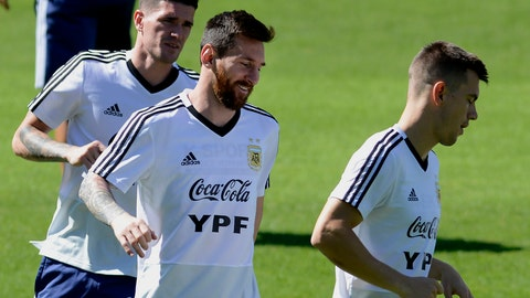 <p>               Argentina's Lionel Messi, center, warms up with teammates during a practice session of the national soccer team in Belo Horizonte, Brazil, Tuesday, June 18, 2019. Argentina will face Paraguay tomorrow in a Copa America Group B soccer match. (AP Photo/Eugenio Savio)             </p>