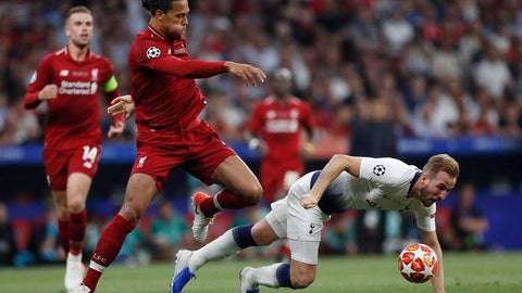 <p>               Tottenham's Harry Kane falls in front of Liverpool's Virgil Van Dijk during the Champions League final soccer match between Tottenham Hotspur and Liverpool at the Wanda Metropolitano Stadium in Madrid, Saturday, June 1, 2019. (AP Photo/Bernat Armangue)             </p>