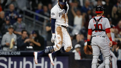 <p>               San Diego Padres' Fernando Tatis Jr., center, jumps after scoring against the Washington Nationals during the eighth inning of a baseball game Thursday, June 6, 2019, in San Diego. (AP Photo/Gregory Bull)             </p>