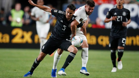 <p>               Mexico defender Diego Reyes, left, fights for control of the ball with Canada forward Lucas Cavallini during the first half of a CONCACAF Gold Cup soccer match Wednesday, June 19, 2019, it Mile High Stadium in Denver. (AP Photo/David Zalubowski)             </p>
