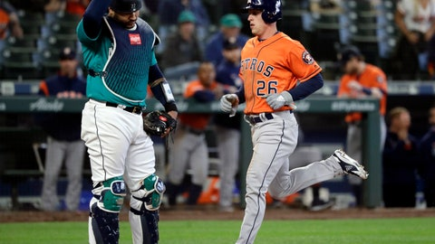 <p>               Seattle Mariners catcher Omar Narvaez, left, looks down as Houston Astros' Myles Straw scores during the 14th inning of a baseball game Thursday, June 6, 2019, in Seattle. (AP Photo/Elaine Thompson)             </p>