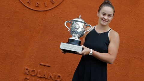 <p>               Australia's Ashleigh Barty poses with the trophy during a photo call at the Roland Garros stadium in Paris, Sunday, June 9, 2019. Barty won the French Open tennis tournament women's final on Saturday June 8, 2019. (AP Photo/Michel Euler)             </p>
