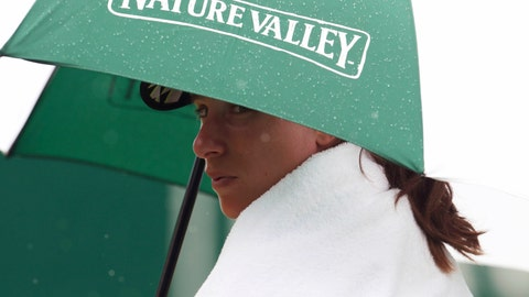 <p>               Johanna Konta sits under an umbrella before the Women's Singles match during day four of the Nature Valley International at Devonshire Park in Eastbourne, England, Wednesday June 26, 2019. While much of Europe is basking in sunshine and high temperatures, many in England are sheltering under umbrellas.  (Bradley Collyer/PA via AP)             </p>
