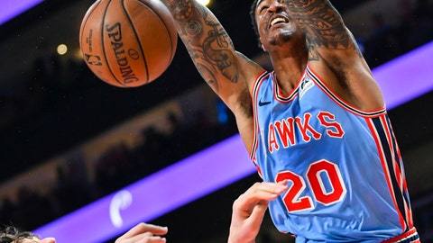 <p>               FILE - In this April 3, 2019, file photo, Atlanta Hawks forward John Collins (20) dunks on Philadelphia 76ers center Boban Marjanovic during the first half of an NBA basketball game, in Atlanta. With a pair of picks in the top 10 — or perhaps a single selection that's higher than what they have now, should they work out a trade — the Hawks can add to a pair of gems from the last two NBA drafts, Trae Young and John Collins. (AP Photo/John Amis, File)             </p>