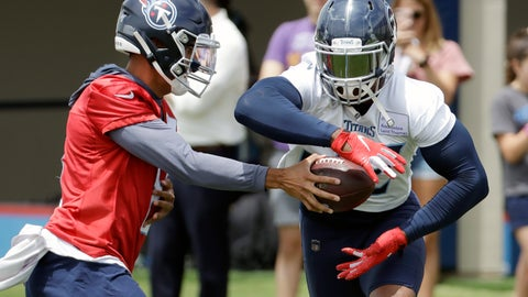 <p>               Tennessee Titans quarterback Marcus Mariota hands off to running back Derrick Henry during an organized team activity at the Titans' NFL football training facility Tuesday, June 11, 2019, in Nashville, Tenn. Both players are in the final year of their contract. (AP Photo/Mark Humphrey)             </p>