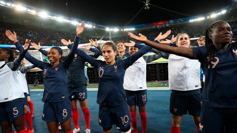 <p>               France's players celebrate at the end of the Group A soccer match between France and South Korea on the occasion of the Women's World Cup at the Parc des Princes in Paris, Friday, June 7, 2019. (AP Photo/Francisco Seco)             </p>