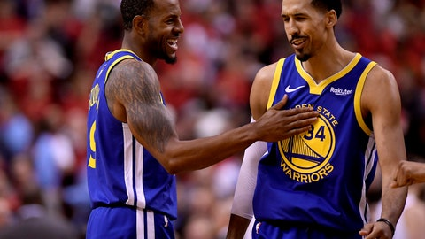 <p>               Golden State Warriors forward Andre Iguodala (9) and teammate Shaun Livingston (34) celebrate their win against the Toronto Raptors following the second half of Game 2 of basketball's NBA Finals, Sunday, June 2, 2019, in Toronto. (Frank Gunn/The Canadian Press via AP)             </p>