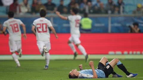 <p>               Uruguay's Diego Laxalt lying on the pitch as Japan players celebrate their side's first goal during a Copa America Group C soccer match at the Arena Gremio in Porto Alegre, Brazil, Thursday, June 20, 2019. (AP Photo/Edison Vara)             </p>