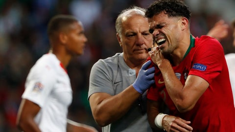 <p>               Portugal's Pepe, right, grimaces in pain after a tackle by Switzerland's Manuel Akanji during the UEFA Nations League semifinal soccer match between Portugal and Switzerland at the Dragao stadium in Porto, Portugal, Wednesday, June 5, 2019. (AP Photo/Armando Franca)             </p>