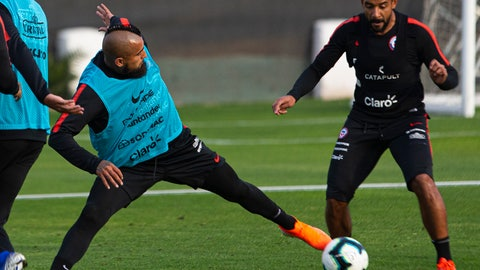 <p>               Chile's soccer player Arturo Vidal controls the ball next to Jean Beausejour during a training session in Santiago, Chile, Monday, June 3, 2019, ahead of the Copa America in neighboring Brazil. (AP Photo/Esteban Felix)             </p>