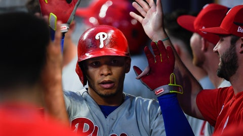 <p>               Philadelphia Phillies second baseman Cesar Hernandez is congratulated in the dugout after hitting a home run during the fourth inning of a baseball game against the Atlanta Braves, Saturday, June 15, 2019, in Atlanta. (AP Photo/John Amis)             </p>