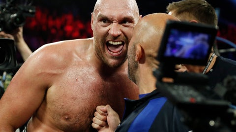 <p>               Tyson Fury, of England, celebrates after defeating Tom Schwarz, of Germany, in a heavyweight boxing match Saturday, June 15, 2019, in Las Vegas. (AP Photo/John Locher)             </p>