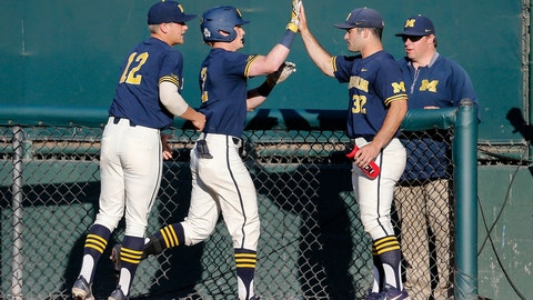 <p>               Michigan's Jack Blomgren, second from left, is greeted by teammates after hitting a a single during the second inning of an NCAA college baseball tournament super regional game in Los Angeles, Sunday, June 9, 2019. (AP Photo/Ringo H.W. Chiu)             </p>