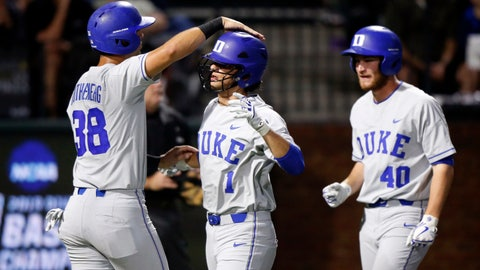 <p>               Duke's Michael Rothenberg (38) congratulates Ethan Murray (1) after they both scored in the second inning of an NCAA college super regional baseball game against Vanderbilt on Friday, June 7, 2019, in Nashville, Tenn. RJ Schreck (40) follows. (AP Photo/Wade Payne)             </p>