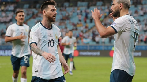 <p>               Argentina's Sergio Aguero, right, celebrates with his teammate Lionel Messi after scoring their side's second goal against Qatar during a Copa America Group B soccer match at Arena do Gremio in Porto Alegre, Brazil, Sunday, June 23, 2019. (AP Photo/Silvia Izquierdo)             </p>