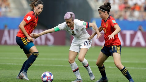 <p>               United States'Megan Rapinoe, middle, is challenged by Spain's Vicky Losada, left, and her teammate Lucia Garcia during the Women's World Cup round of 16 soccer match between Spain and US at the Stade Auguste-Delaune in Reims, France, Monday, June 24, 2019. (AP Photo/Alessandra Tarantino)             </p>