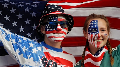 <p>               Brothers Austin, left, and Jordyn Chambers, from Philadelphia, hold up an US flag prior the Women's World Cup Group F soccer match between United States and Chile at Parc des Princes in Paris, France, Sunday, June 16, 2019. (AP Photo/Alessandra Tarantino)             </p>