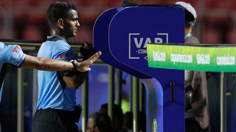 <p>               Referee Alexis Herrera reviews a play on the VAR stand during a Copa America Group B soccer match between Colombia and Qatar at Morumbi stadium in Sao Paulo, Brazil, Wednesday, June 19, 2019. (AP Photo/Victor R. Caivano)             </p>