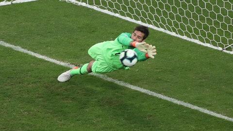 <p>               Brazil's goalkeeper Alison blocks the penalty kick by Paraguay's Gustavo Gomez during a Copa America quarterfinal soccer match at Arena do Gremio in Porto Alegre, Brazil, Thursday, June 27, 2019. (AP Photo/Ricardo Mazalan)             </p>