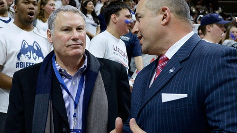 <p>               FILE - In this Feb. 13, 2017, file photo, American Athletic Conference commissioner Mike Aresco, left, talks with Connecticut athletic director David Benedict, right, before an NCAA college basketball game between UConn and South Carolina in Storrs, Conn. On Thursday, June 27, 2019, Aresco said that there is no chance it will allow UConn to stay as a football-only member in the American after most of UConn's athletic programs were officially welcomed back into the Big East, a conference which does not offer football. (AP Photo/Jessica Hill, File)             </p>
