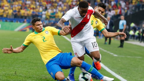 <p>               Brazil's Thiago Silva, let, and Peru's Jefferson Farfan battle for the ball during a Copa America Group A soccer match at the Arena Corinthians in Sao Paulo, Brazil, Saturday, June 22, 2019. (AP Photo/Victor R. Caivano)             </p>