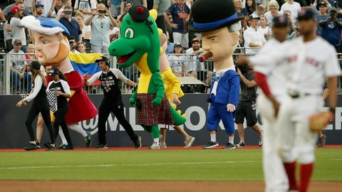 <p>               Characters including from left, King Henry VIII, the Loch Ness monster and Winston Churchill participate in a mascot race during a baseball game between the Boston Red Sox and the New York Yankees, Saturday, June 29, 2019, in London. Major League Baseball made its European debut game Saturday at London Stadium. (AP Photo/Tim Ireland)             </p>