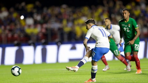 <p>               Brazil's Phlippe Coutinho scores from the penalty spot his side's opening goal during a Copa America Group A soccer match against Bolivia at the Morumbi stadium in Sao Paulo, Brazil, Friday, June 14, 2019. (AP Photo/Andre Penner)             </p>