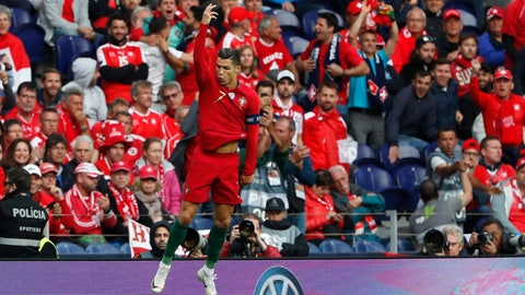 <p>               Portugal's Cristiano Ronaldo celebrates after scoring his side's opening goal during the UEFA Nations League semifinal soccer match between Portugal and Switzerland at the Dragao stadium in Porto, Portugal, Wednesday, June 5, 2019. (AP Photo/Armando Franca)             </p>