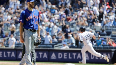 <p>               New York Mets starting pitcher Zack Wheeler, left, reacts as New York Yankees' Gio Urshela runs the bases after hitting a two-run home run during the fourth inning in the first baseball game of a doubleheader, Tuesday, June 11, 2019, in New York. (AP Photo/Frank Franklin II)             </p>