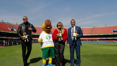 <p>               Brazilian singer Leo Santana, left, and Colombian singer Karol G, second right, artists that will perform at the opening ceremony of the Copa America on Friday, pose for pictures with the tournament's mascot Zizito and Brazilian former soccer player Cafu, right, at the Morumbi stadium n Sao Paulo, Brazil, Wednesday, June 12, 2019. The Copa America soccer tournament will run from June 14 until July 7 in Brazil. (AP Photo/Andre Penner)             </p>