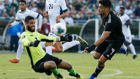 <p>               Cuba goalkeeper Sandy Sanchez (1) makes save against Mexico forward Raúl Jimenez (9) during the first half of a CONCACAF Gold Cup soccer match in Pasadena, Calif., Saturday, June 15, 2019. (AP Photo/Ringo H.W. Chiu)             </p>