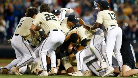 <p>               Vanderbilt players celebrate after defeating Michigan in Game 3 of the NCAA College World Series baseball finals in Omaha, Neb., Wednesday, June 26, 2019. (AP Photo/John Peterson)             </p>